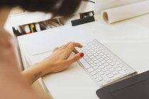 Female hand typing on keyboard. — Stock Photo