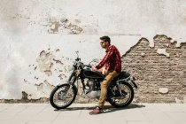 Young man on motorcycle — Stock Photo