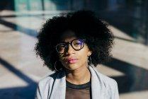 Woman in eyeglasses looking at camera — Stock Photo