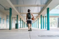 Man with ball walking — Stock Photo