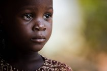 BENIN, AFRICA - AUGUST 30, 2017: Portrait of adorable young child looking away. — Stock Photo