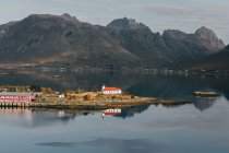 View of island with rural houses amid of mountain lake — Stock Photo