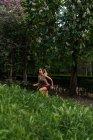 Girl jogging up slope at park — Stock Photo