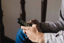 Crop male hands chatting on smartphone at staircase — Stock Photo
