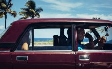 CUBA - AUGUST 27, 2016: Man in car on coastal road looking at camera — Stock Photo