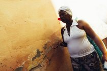 CUBA - AUGUST 27, 2016: Portrait of woman standing at street with weathered wall — Stock Photo