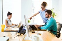 Scene with business people working in modern office. — Stock Photo