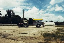 CUBA - AUGUST 27, 2016: Side view of tractor with truck body parked on square on sunny day — Stock Photo