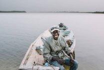 Goree, Senegal- December 6, 2017: Smiling old man on boat at river — Stock Photo