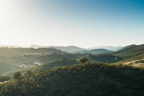 Scenic landscape of sunlit misty mountains valley — Stock Photo