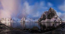 Panoramic view of winter mountain lake at dusk — Stock Photo