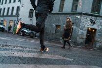 Crop Jogger running on street scene — Stock Photo