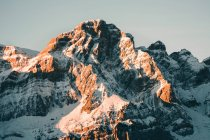 Picturesque view of sunlit rocky mountains — Stock Photo