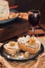 Close up view of slices of bread with cheese and wine — Stock Photo