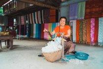 LAOS- FEBRUARY 18, 2018: Smiling woman producing fabric — Stock Photo