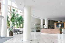 Big hall with white columns in hotel — Stock Photo