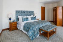 Room interior with blue and white bed at bedroom — Stock Photo