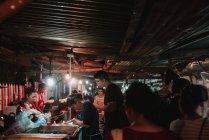 LAOS, LUANG PRABANG: People buying traditional food at counter on market. — Stock Photo