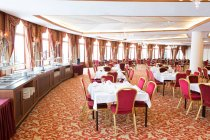 Interior view of big restaurant hall with served tables — Stock Photo