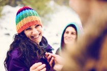 Friends having time outdoor in winter woods — Stock Photo
