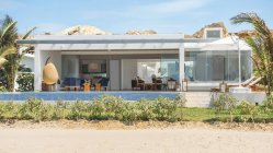 Exterior view of big  modern villa with pool in sunny day. — Stock Photo
