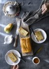 Directly above of freshly baked pear cake with tea on rustic table. — Stock Photo