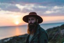 Thoughtful bearded man on coast — Stock Photo