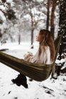 Woman in hammock in winter — Stock Photo
