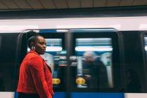 Woman standing in underground — Stock Photo