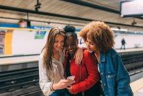 Women standing in subway — Stock Photo