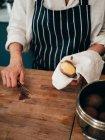 Chef peeling potato — Stock Photo