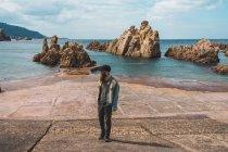 Bearded man walking on embankment — Stock Photo