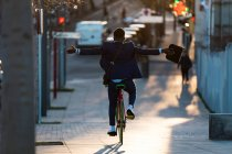 Man riding bicycle without hands — Stock Photo