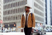 Black man walking on street — Stock Photo