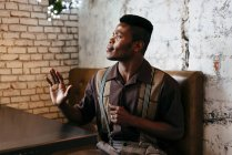Man in classic clothes sitting in cafe — Stock Photo