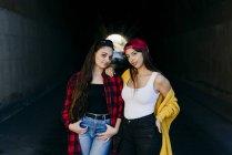 Women standing in underpass — Stock Photo