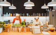 Two women cooking in cafe — Stock Photo