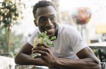 Man drinking summer soft drink — Stock Photo