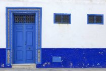 Typical arabic entrance doors on blue and white building, Morocco — Stock Photo