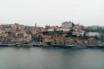 Channel and old city with orange roofs in overcast, Porto, Portugal — Stock Photo