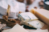 Cheese board with nuts — Stock Photo