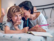 Mother and kid coloring pictures — Stock Photo