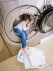 Boy sleeping into laundry machine — Stock Photo