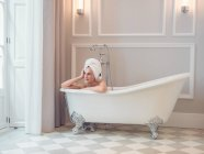 Young woman relaxing in bath — Stock Photo