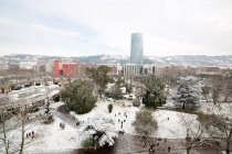Aerial view to park and houses covered with snow in Bilbao, Spain. — Stock Photo