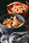 Bowls of salad with chicken — Stock Photo