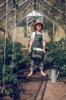 Boy standing in greenhouse — Stock Photo