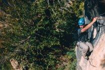 Man climbing up on rock — Stock Photo