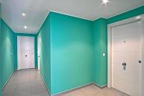Interior of modern mint corridor with white doors — Stock Photo