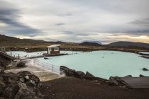 Mountain pond between volcanoes and geysers with picturesque view of landscape in Iceland — Stock Photo